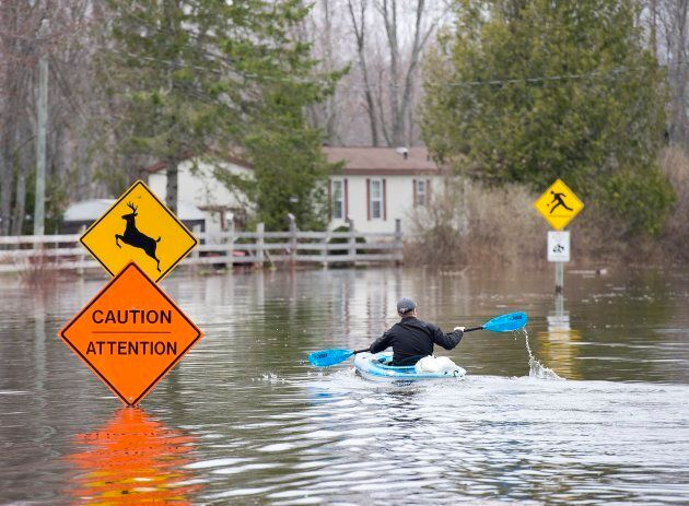A resident paddles his kayak at Darlings Island, N.B. on