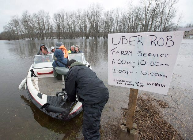 Rob Dekany, known locally as Uber Rob, ferries stranded passengers at Darlings Island, N.B. on
