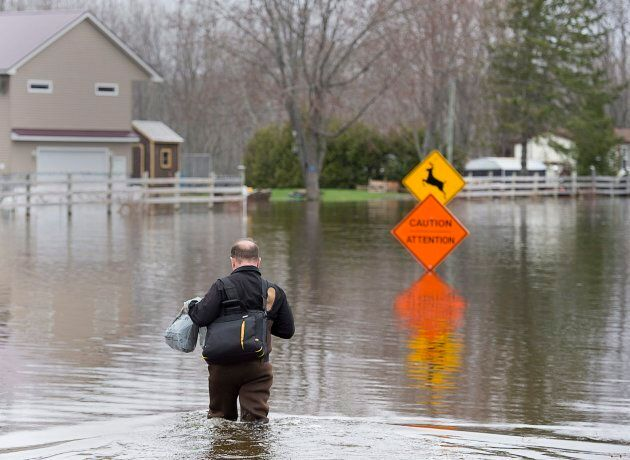 A resident heads home at Darlings Island, N.B. on May 3, 2018 as the Kennebecasis River flooded the only...