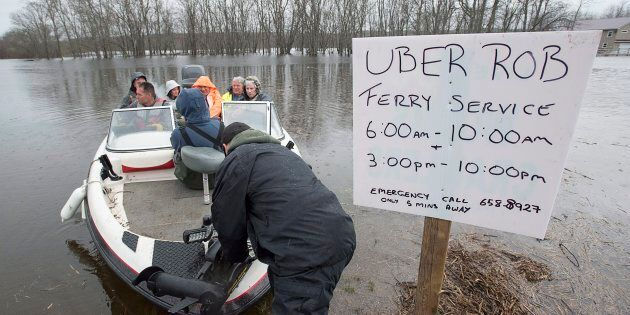 Rob Dekany, known locally as Uber Rob, ferries stranded passengers at Darlings Island, N.B. on May 3,...
