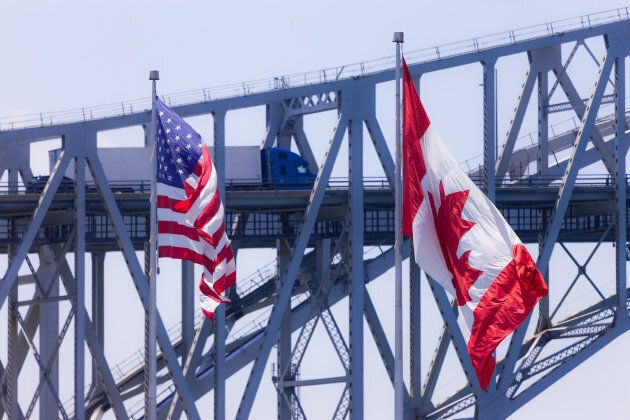 Vehicles make their way across the Blue Water Bridge in Sarnia, Canada, on June 11,