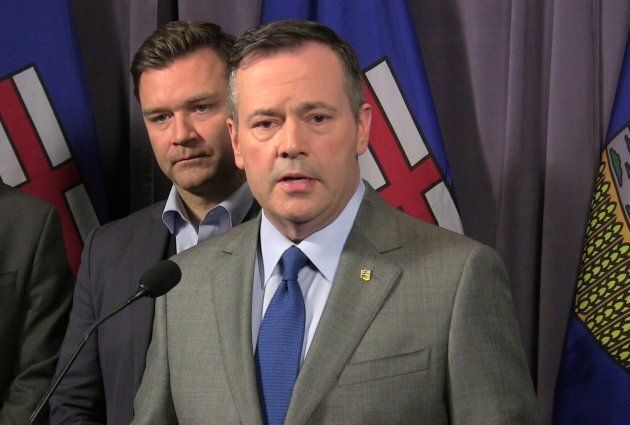 Jason Kenney speaks to reporters as Edmonton-Riverbend Conservative MP Matt Jeneroux looks on at the...