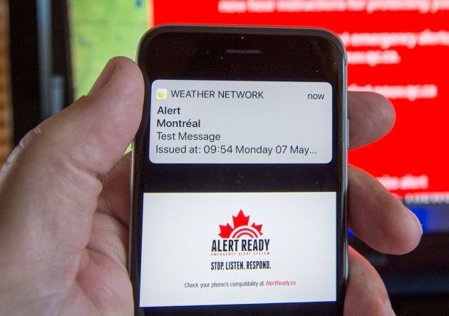 A smartphone and a television receive visual and audio alerts to test Alert Ready, a national public...