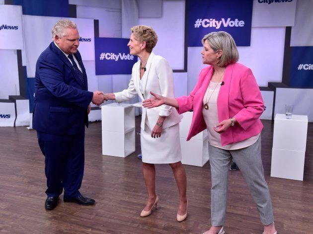 Liberal Premier Kathleen Wynne, centre, Progressive Conservative Leader Doug Ford, left, and NDP Leader...