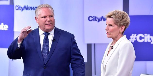 Liberal Premier Kathleen Wynne, right, and Progressive Conservative Leader Doug Ford take part in an...