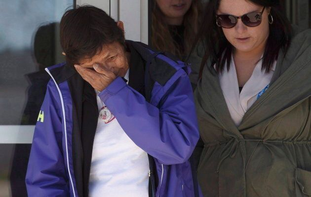 Jackie Janvier, mother of shooting victim Marie Janvier, wipes away tears while leaving court after giving...