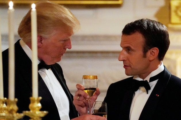 French President Emmanuel Macron toasts U.S. President Donald Trump during a state dinner at the White...