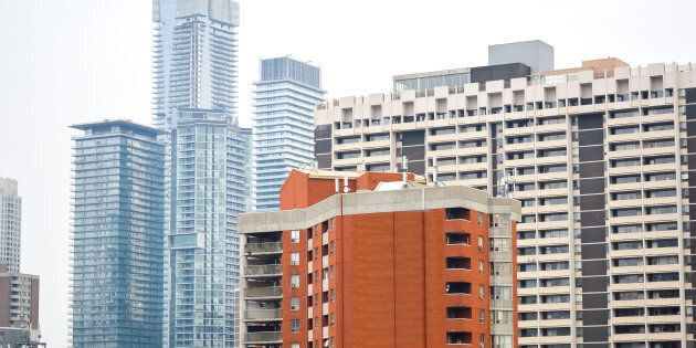 Condo and apartment buildings in downtown Toronto. A new index of rental housing costs shows rental housing...