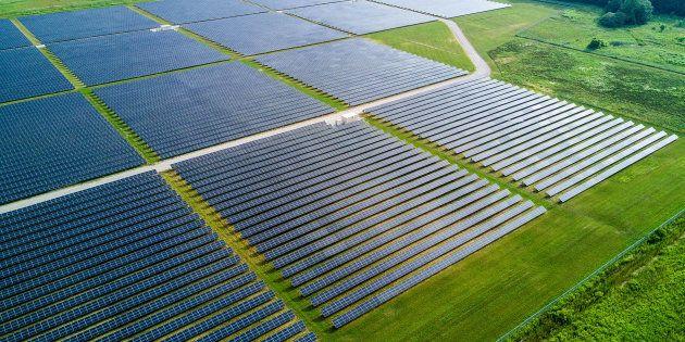 Solar panels stand in this aerial photograph taken above the Enbridge Inc. Sarnia Solar Farm in Sarnia,...