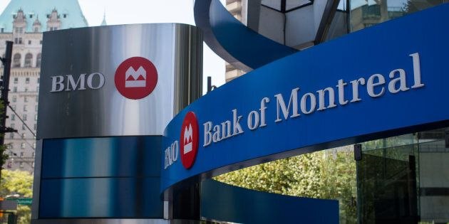 Bank of Montreal signage outside a branch in Vancouver, B.C., Fri. Aug. 25 2017. The bank has cut its...