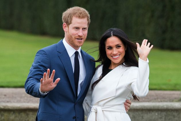 Prince Harry and Meghan Markle attend a photocall in the Sunken Gardens at Kensington Palace following the announcement of their engagement on Nov. 27, 2017 in London.