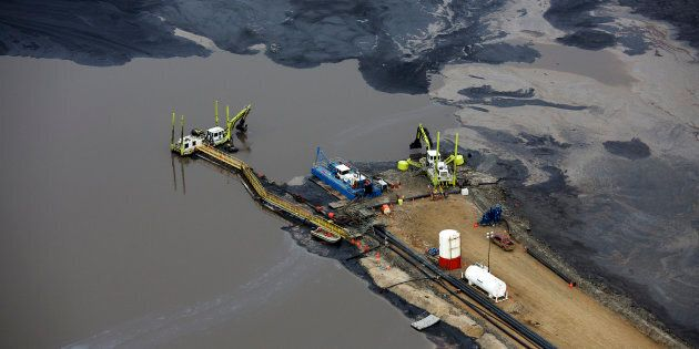 Heavy equipment at a tailings pond at the Suncor oilsands operation near Fort McMurray, Alta., Sept....