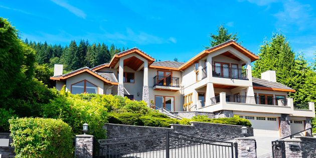 A luxury home is pictured in a wealthy subdivision in Greater Vancouver. The luxury housing markets in Toronto and Vancouver are undergoing a major correction, with sales plummeting from year-ago levels and once rapidly-rising prices now under pressure, according to new reports released this week.