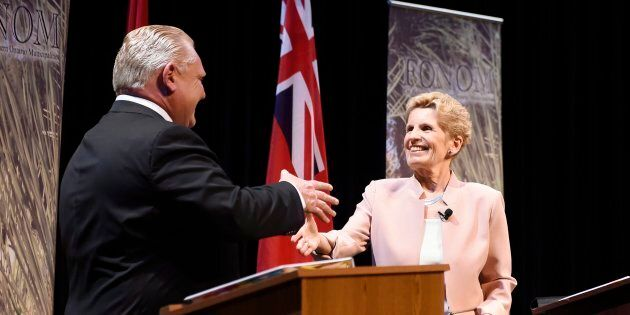 Ontario Progressive Conservative Leader Doug Ford, left, and Ontario Liberal Leader Kathleen Wynne shake...