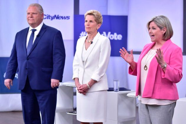 Liberal Premier Kathleen Wynne, centre, Progressive Conservative Leader Doug Ford, left, and NDP Leader...