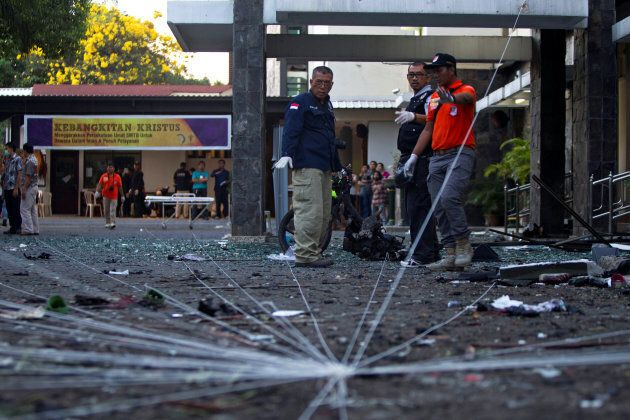 Police forensic team examine the scene of a bomb at a church in Surabaya, East Java, Indonesia on May...