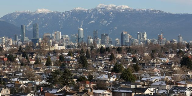 Rooftops of houses in the Kitsilano neighbourhood and the downtown core are seen in Vancouver, Jan. 7,