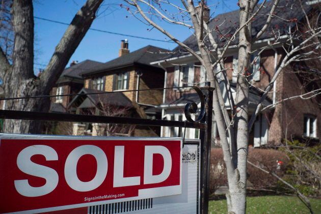 A sold sign is shown in front of west-end Toronto homes April 9,