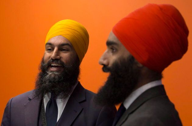 NDP leader Jagmeet Singh (left) and his brother Gurratan Singh pose for a photo at the party offices...