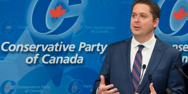 Conservative Leader Andrew Scheer speaks to reporters during a meeting of the General Council of the...