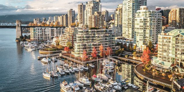 Condo buildings along Vancouver's False Creek. StatCan data shows the rate of people leaving Vancouver...