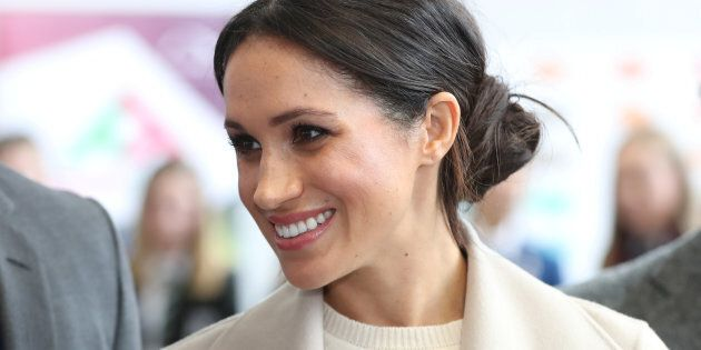 Meghan Markle smiles during a visit to the Eikon Exhibition Centre in Lisburn, Northern Ireland on March...