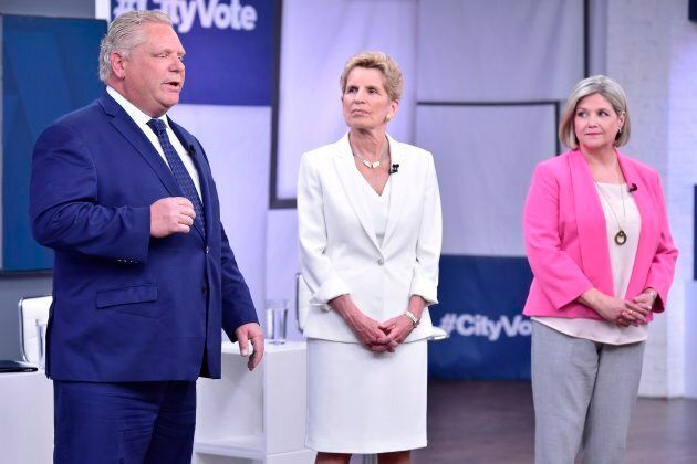 Ontario Liberal Leader Kathleen Wynne, centre, Progressive Conservative Leader Doug Ford, left, and NDP...
