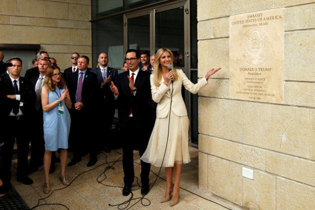 Senior White House Adviser Ivanka Trump and U.S. Treasury Secretary Steven Mnuchin stand next to the...