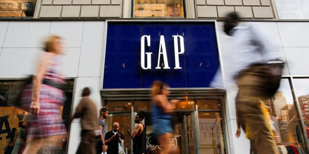 People pass by the GAP clothing retail store in Manhattan, New York, U.S., Aug. 15,