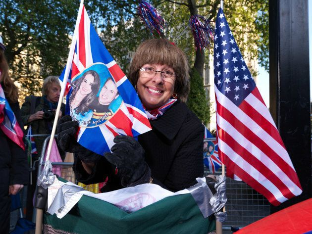 Donna Werner poses for a portrait in front of Westminster Abbey in advance of the royal wedding on April...