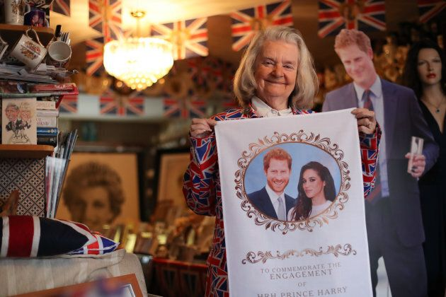 Margaret Tyler holds memorabilia celebrating the upcoming wedding of Prince Harry to Meghan Markle, in her home in north London.
