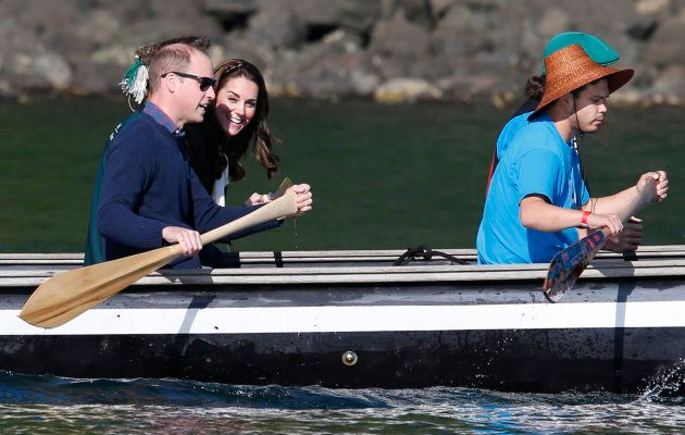 Prince William and Catherine, Duchess of Cambridge, tour in a canoe during a visit to Haida Gwaii in Skidegate, B.C., Sept. 30, 2016.
