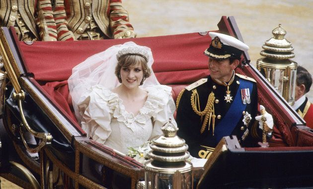 Diana, Princess of Wales and Prince Charles ride in a carriage after their wedding at St. Paul's Cathedral...