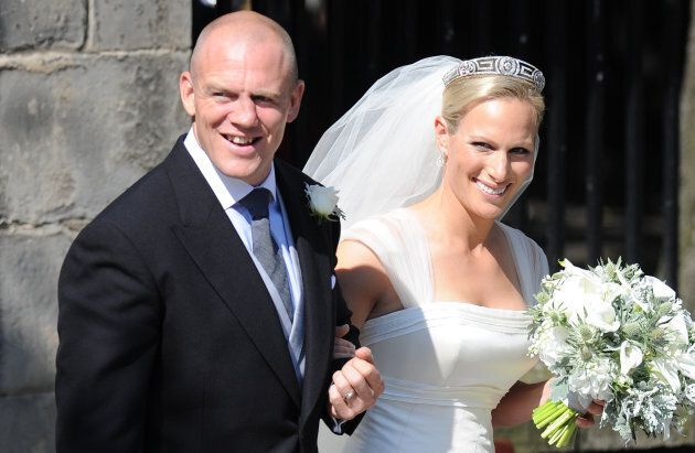 Mike Tindall and Zara Phillips emerge from Canongate Kirk in Edinburgh after their