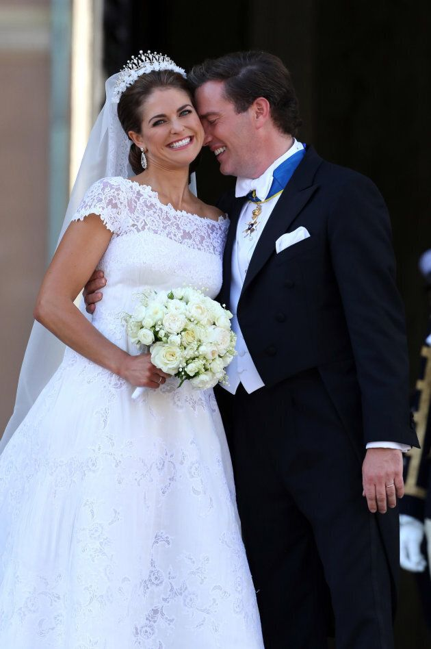Princess Madeleine of Sweden and Christopher O'Neill smile at well wishers following their marriage ceremony...