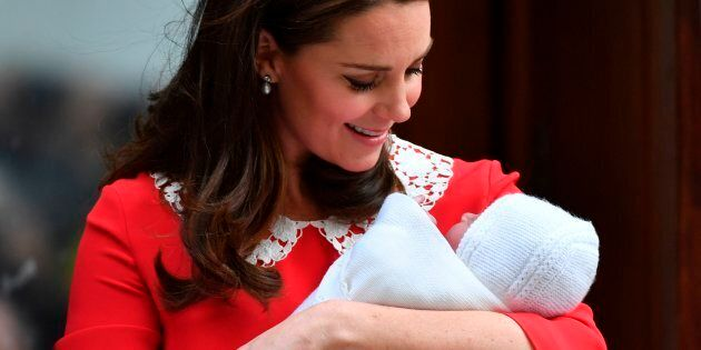 Britain's Catherine, Duchess of Cambridge looks at her newly-born son, her third child, on the steps...