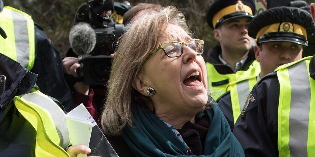 Green Party Leader Elizabeth May thanks supporters as she's arrested by RCMP officers after joining protesters...
