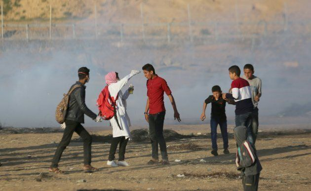 Israeli forces intervene to Palestinian demonstrators using tear gas during a protest, organized to mark...