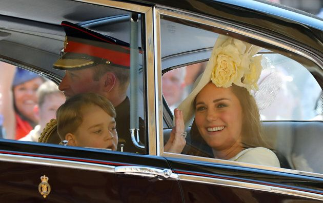The Duke and Duchess of Cambridge and Prince George leave St George's Chapel at Windsor Castle for the...