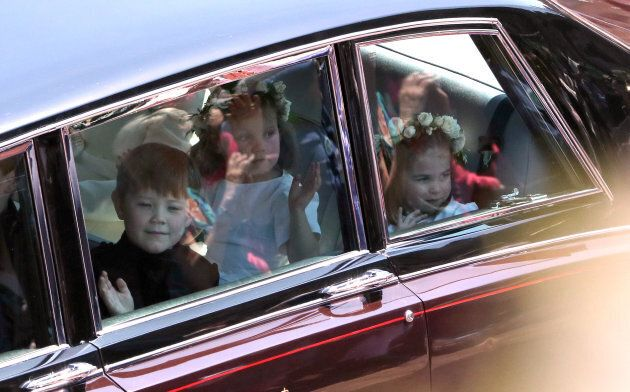 Princess Charlotte (right) arrives for the wedding.