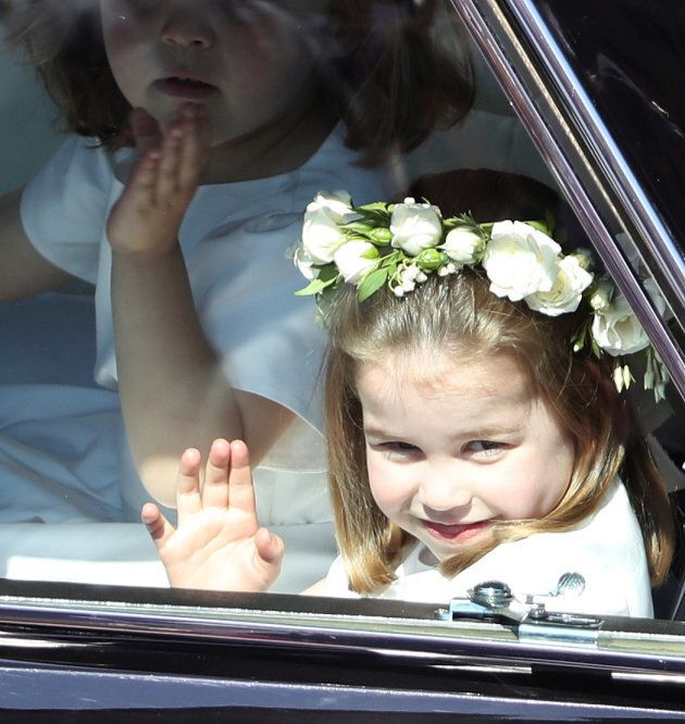 Princess Charlotte waves to the crowd.