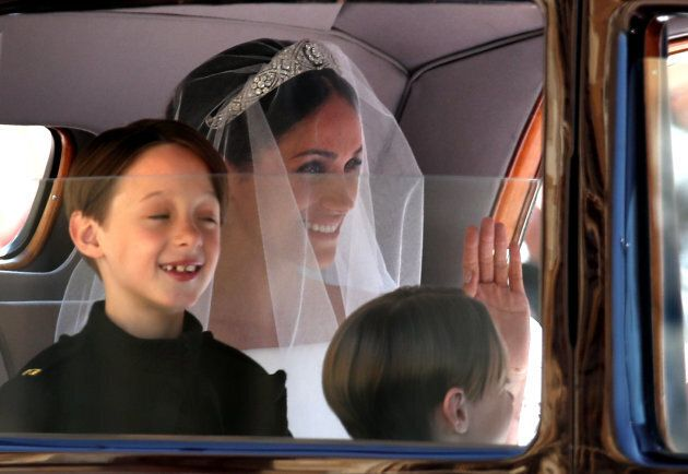 Page boys John and Brian Mulroney with Meghan Markle as she arrives in a car for her wedding to Prince...