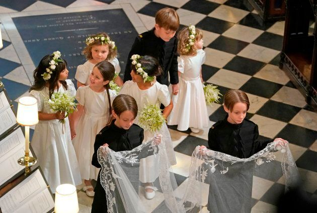 Bridesmaids and page boys, including John and Brian Mulroney, walk behind Meghan Markle during her wedding...