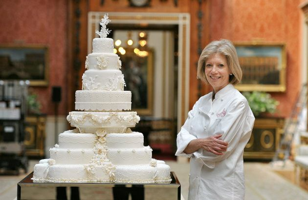 Fiona Cairns stands next to the royal wedding cake that she and her team made for Prince William and Kate Middleton.