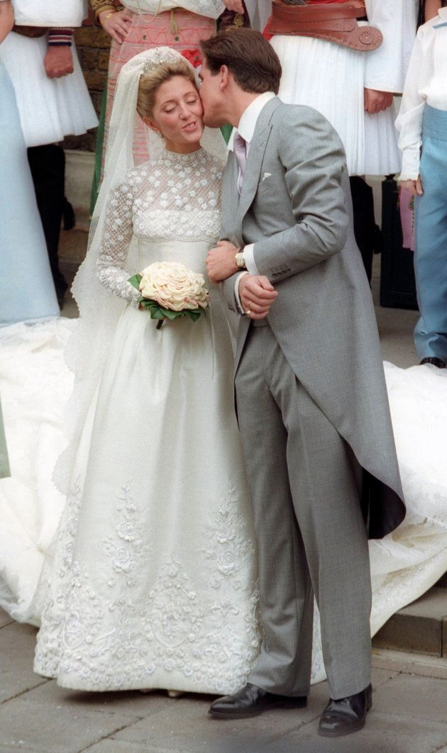 Crown Prince Pavlos kisses Marie-Chantal Miller after their wedding at the Greek Orthodox Cathedral in London July 1, 1995.