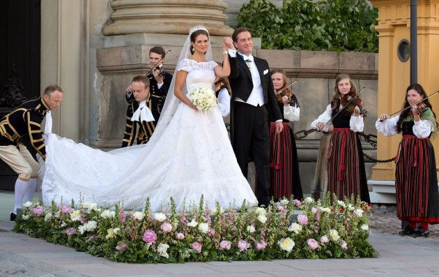 Princess Madeleine of Sweden and Christopher O'Neill greet the public after their wedding ceremony.