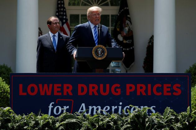 U.S. President Donald Trump and Secretary of Health and Human Services Alex Azar deliver remarks about...