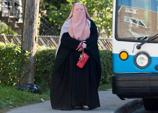 Warda Naili wears a Burka on a street in Montreal, Oct. 21, 2017.