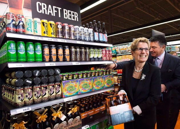 Ontario Premier Kathleen Wynne, left, and Minister of Finance Charles Sousa, right, pick beer at a Loblaws...