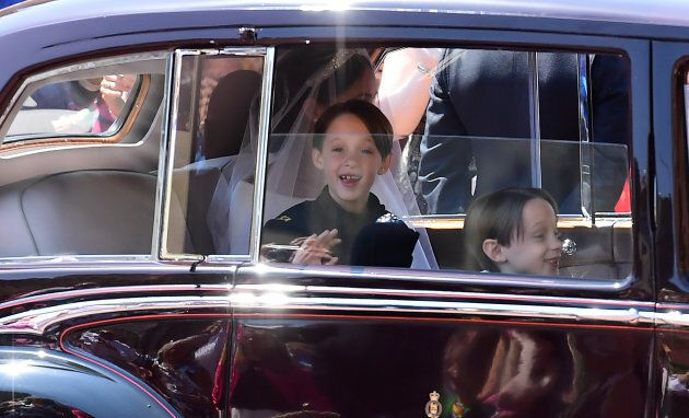 Page boys John and Brian Mulroney accompany Meghan Markle as she arrives in a car for the wedding ceremony to marry Britain's Prince Harry, Duke of Sussex, at St George's Chapel, Windsor Castle, in Windsor, on May 19, 2018.